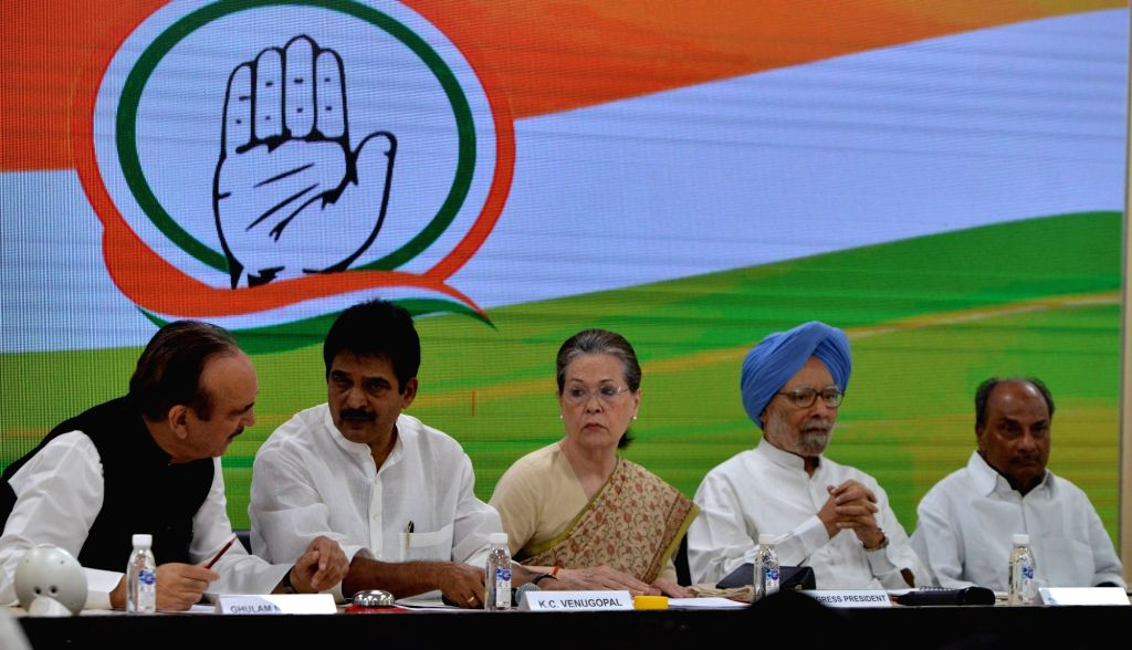 New Delhi: Congress interim President Sonia Gandhi with party leaders Ghulam Nabi Azad, K. C. Venugopal, Dr Manmohan Singh and A. K. Antony during a meeting of party general secretaries, state in-charges, state unit chiefs and others at party Headqua - Sonia Gandhi and Manmohan Singh