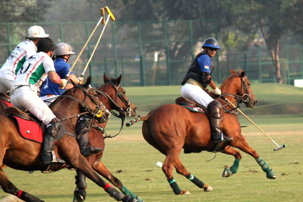 Congress leader and industrialist Naveen Jindal in action during the final match of Indian Open Polo Championship 2014 between Sahara Warrior and Jindal Panther in New Delhi, on Nov 16, ...