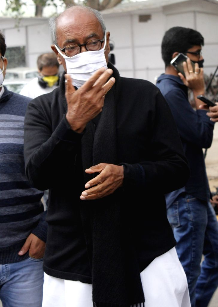 New Delhi: Congress leader Digvijaya Singh arrives to pay tributes to party party veteran Ahmed Patel who passed away at 3.30 am in a Gurugram hospital following Covid-19 complications, in New Delhi on Nov 25, 2020. (Photo: IANS) - Digvijaya Singh and Ahmed Patel