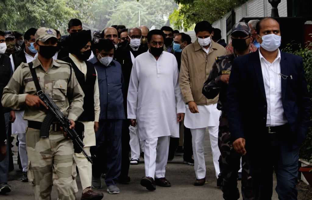 New Delhi: Congress leader Kamal Nath arrives to pay tributes party veteran to Ahmed Patel who passed away at 3.30 am in a Gurugram hospital following Covid-19 complications, in New Delhi on Nov 25, 2020. (Photo: IANS) - Kamal Nath and Ahmed Patel