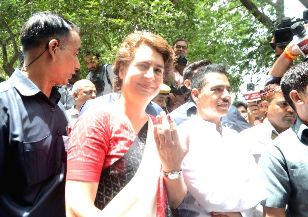 New Delhi: Congress leader Priyanka Gandhi Vadra and her husband Robert Vadra arrive to cast their vote at Sardar Patel Vidyalaya in New Delhi's Lodhi Estate on May 12, 2019. (Photo: Bidesh Manna/IANS) - Priyanka Gandhi Vadra and Sardar Patel Vidyalaya