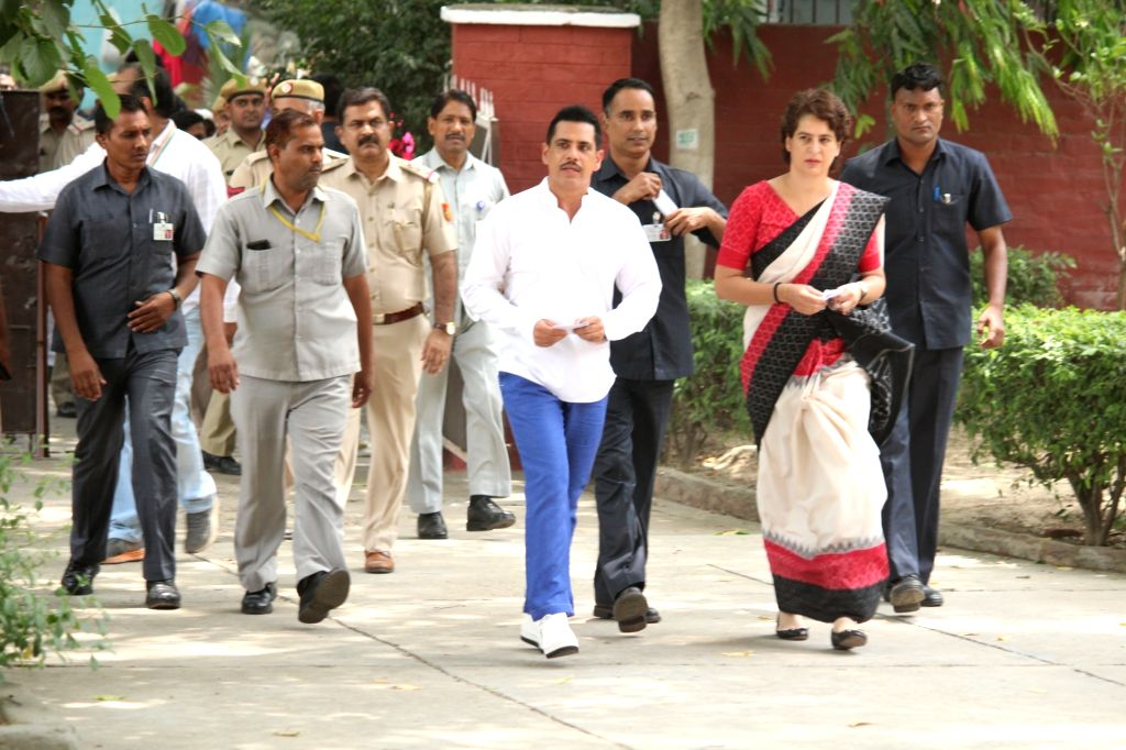 New Delhi: Congress leader Priyanka Gandhi Vadra and her husband Robert Vadra arrive to cast their vote at Sardar Patel Vidyalaya in New Delhi's Lodhi Estate on May 12, 2019. (Photo: Amlan Paliwal/IANS) - Priyanka Gandhi Vadra and Sardar Patel Vidyalaya