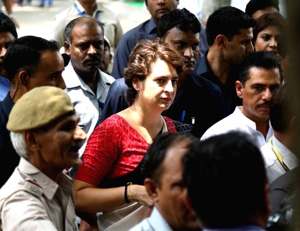 New Delhi: Congress leader Priyanka Gandhi Vadra and her husband Robert Vadra arrive to cast their vote at Sardar Patel Vidyalaya in New Delhi's Lodhi Estate on May 12, 2019. (Photo: Amlan Paliwal/IANS) - Priyanka Gandhi Vadra and Sardar Patel Vidyalaya
