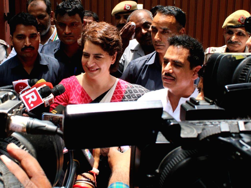 New Delhi: Congress leader Priyanka Gandhi Vadra talks to press after casting vote at Sardar Patel Vidyalaya in New Delhi's Lodhi Estate on May 12, 2019. Also seen her husband Robert Vadra (Photo: Amlan Paliwal/IANS) - Priyanka Gandhi Vadra and Sardar Patel Vidyalaya