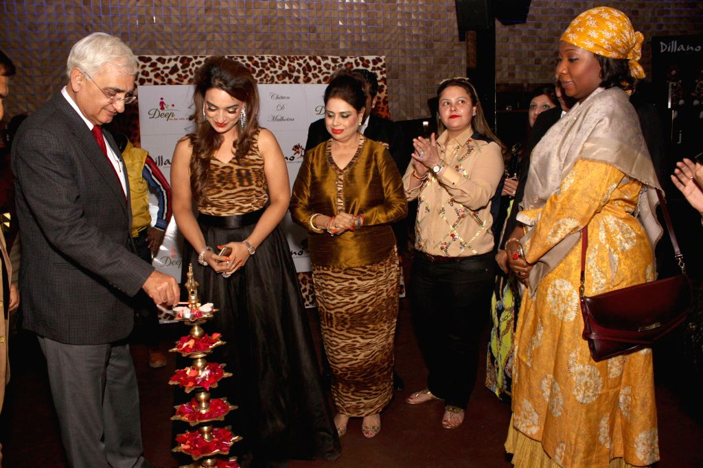 Congress leader Salman Khurshid with jewellery designer Chitwan Malhotra during the launch of her jewellery collection in New Delhi on Dec 9, 2014.