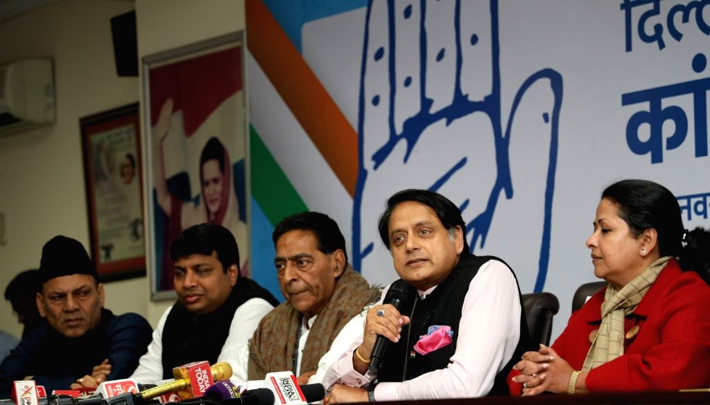 New Delhi: Congress leader Shashi Tharoor accompanied by Delhi party president Subhash Chopra addresses a press conference at the launch of a campaign to crowd source ideas and suggestions from the people of Delhi to be incorporated in the Congress m - Shashi Tharoor and Subhash Chopra