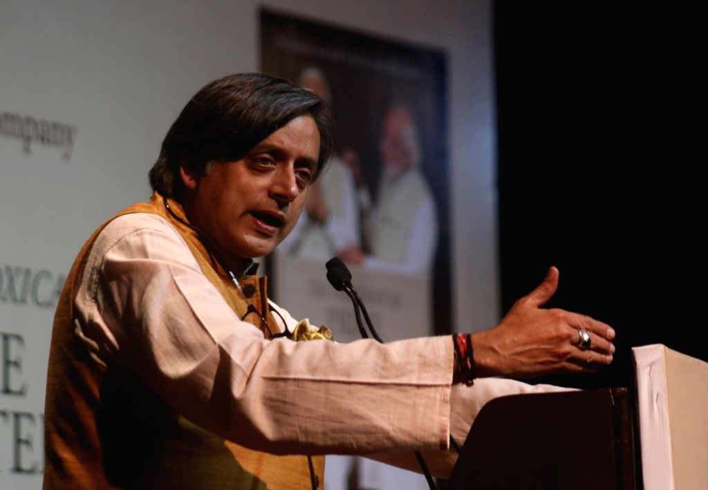 ": New Delhi: Congress leader Shashi Tharoor addresses at the launch of his book ""The Paradoxical Prime Minister: Narendra Modi And His India"" in New Delhi on Oct 26, 2018. (Photo: IANS)."