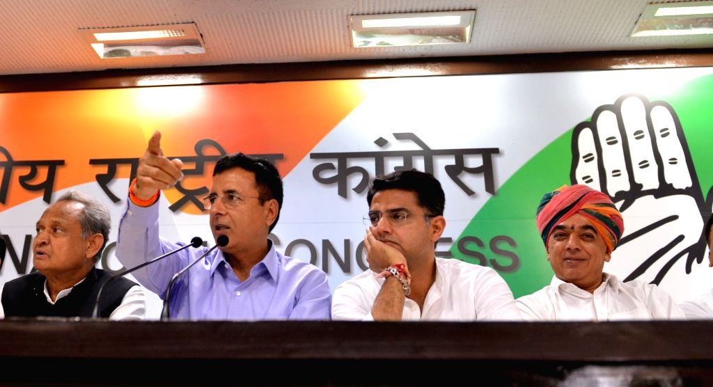 :New Delhi: Congress leaders Ashok Gehlot, Randeep Surjewala and Sachin Pilot with Former Rajasthan BJP MLA Manvendra Singh - the son of BJP veteran and former Union Minister Jaswant Singh - during ...