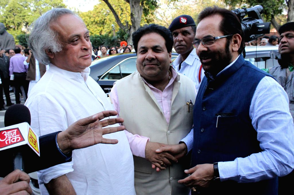 Congress leaders Jairam Ramesh, Rajeev Shukla with the Union Minister of State for Minority Affairs and Parliamentary Affairs Mukhtar Abbas Naqvi at the Parliament House ahead of ...