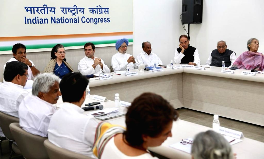New Delhi: Congress leaders Priyanka Gandhi Vadra, Jyotiraditya Scindia, Oommen Chandy, K. C. Venugopal, Sonia Gandhi, Rahul Gandhi, Manmohan Singh, A.K. Antony, Ghulam Nabi Azad and Ambika Soni during the Congress Working Committee (CWC) meeting at  - Priyanka Gandhi Vadra, Sonia Gandhi, Rahul Gandhi and Manmohan Singh