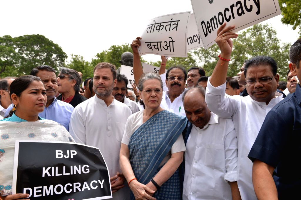 New Delhi: Congress leaders Rahul Gandhi, Sonia Gandhi, A.K. Antony and others stage a demonstration against Karnataka and Goa crisis, outside Parliament House in New Delhi, on July 11, 2019. (Photo: IANS) - Rahul Gandhi and Sonia Gandhi