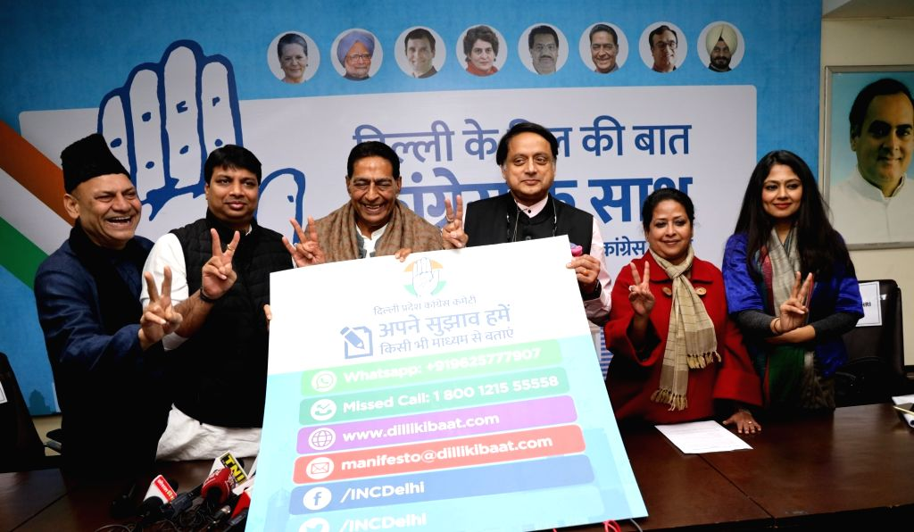 New Delhi: Congress leaders Shashi Tharoor and Subhash Chopra at the launch of a campaign to crowd source ideas and suggestions from the people of Delhi to be incorporated in the Congress manifesto for the Delhi Assembly elections at a press conferen - Shashi Tharoor and Subhash Chopra