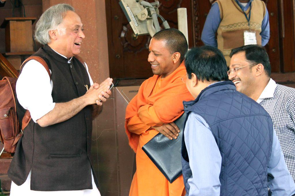 Congress MP Jairam Ramesh and BJP MP from Gorakhpur Yogi Adityanath at the Parliament premises in New Delhi, on Nov 28, 2014.