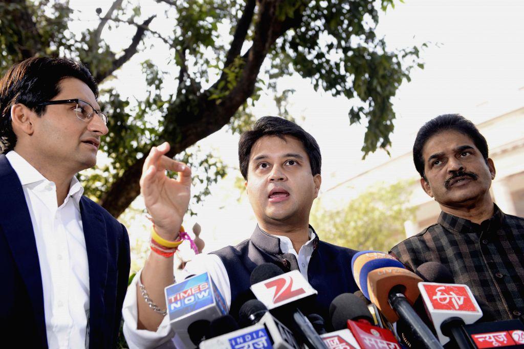 Congress MP Jyotiraditya Scindia addresses press at the Parliament premises in New Delhi, on Dec 17, 2014.