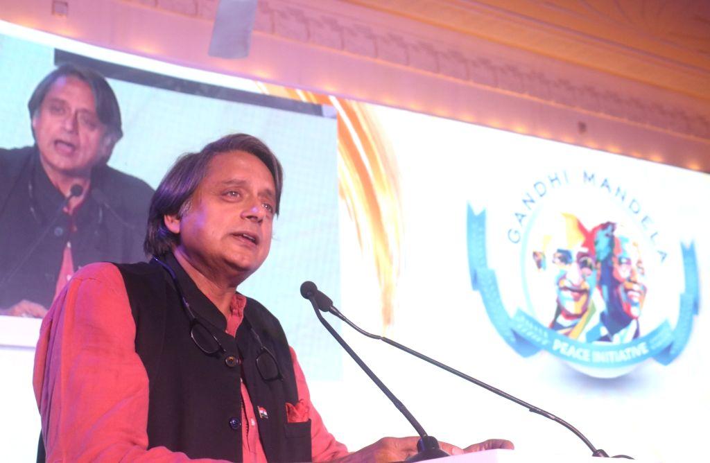 New Delhi: Congress MP Shashi Tharoor addresses at the launch of Gandhi - Mandela Peace Initiative and Scholarship, in New Delhi on July 11, 2019. (Photo: IANS) - Shashi Tharoor