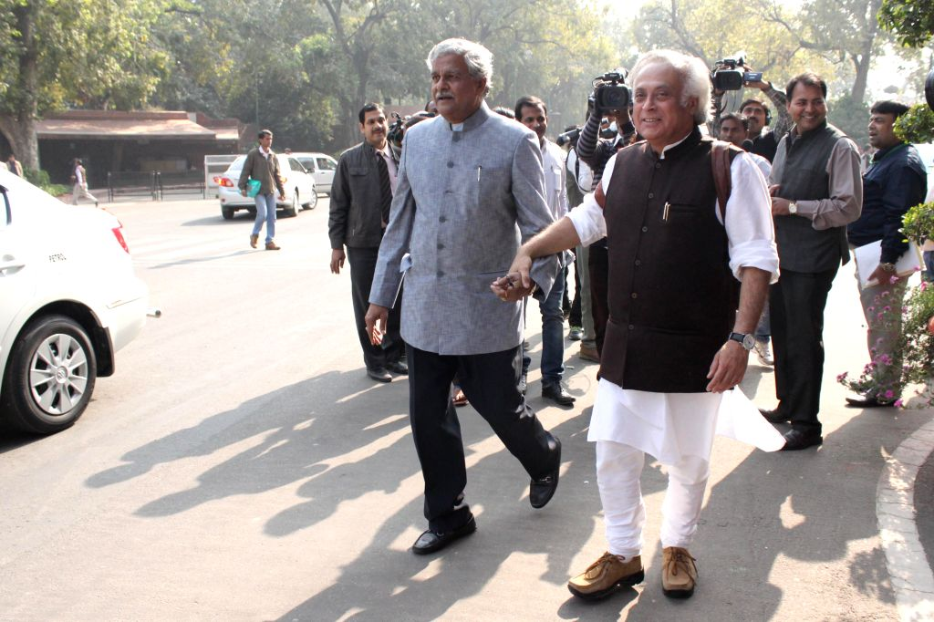 Congress MPs Jairam Ramesh and Sriprakash Jaiswal at the Parliament premises in New Delhi, on Nov 26, 2014.