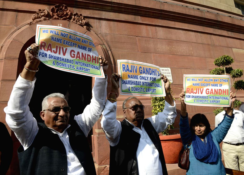 Congress MPs stage a demonstration against renaming of Shamsabad Airport at the Parliament premises in New Delhi, on Nov 25, 2014.