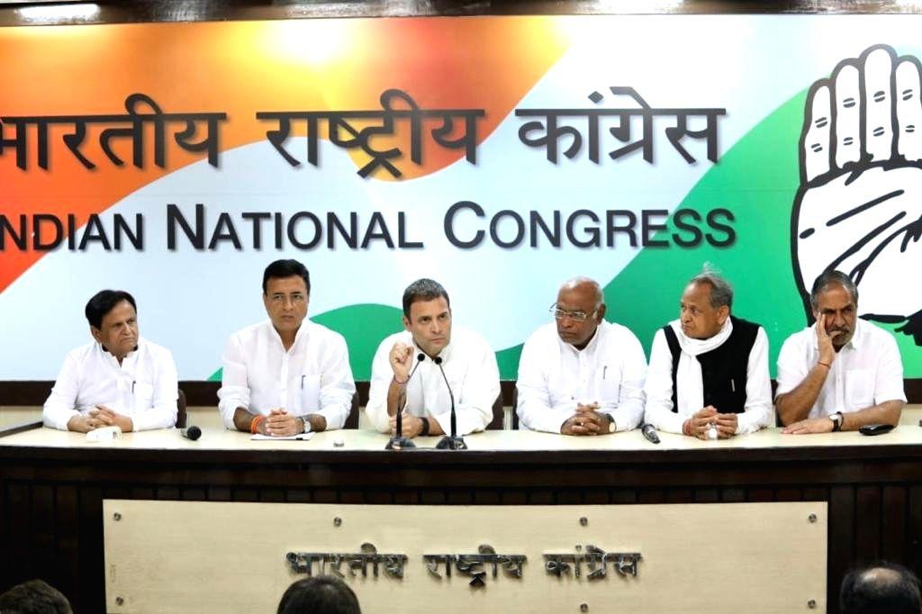 :New Delhi: Congress President Rahul Gandhi addresses a press conference along with party leaders Ahmed Patel, Randeep Singh Surjewala, Mallikarjun Kharge, Ashok Gehlot and Anand Sharma in New ...