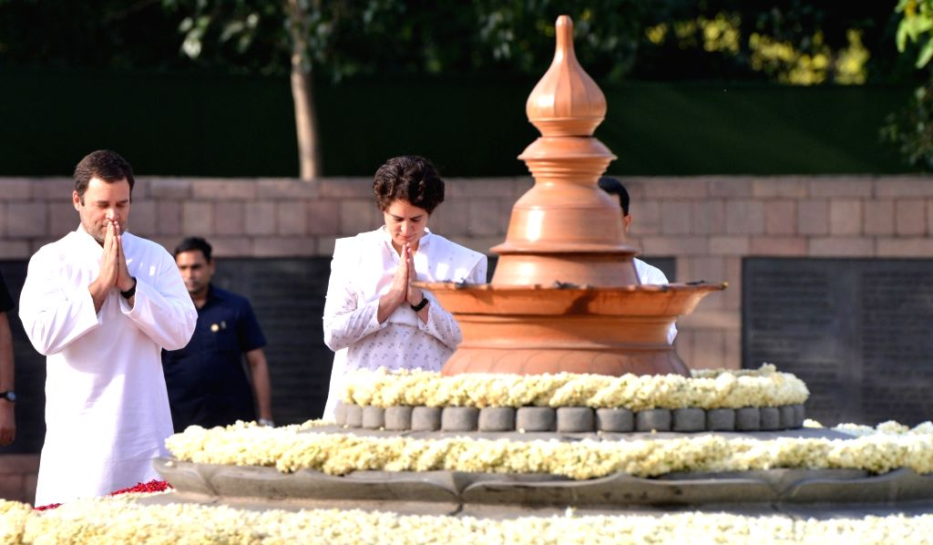 : New Delhi: Congress President Rahul Gandhi and Priyanka Gandhi pay homage to former Prime Minister Rajiv Gandhi on his 27th death anniversary at Vir Bhumi in New Delhi on May 21, 2018. (Photo: ...