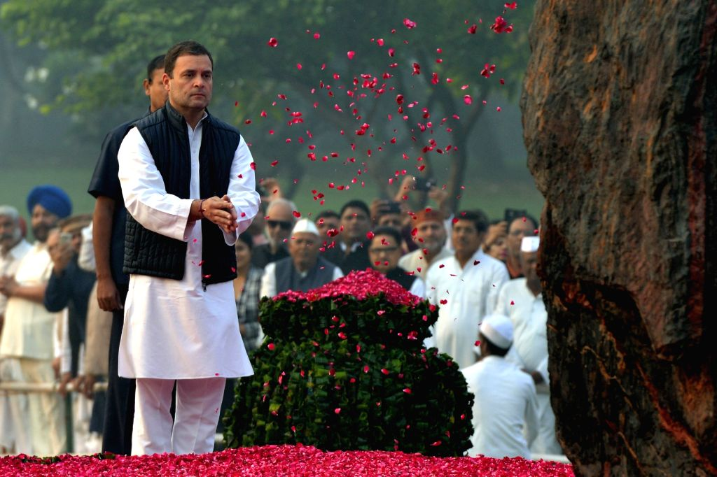 : New Delhi: Congress President Rahul Gandhi offers floral tribute at the memorial of Former Prime Minister Indira Gandhi on her death anniversary at Shakti Sthal in New Delhi on Oct 31, 2018. ...