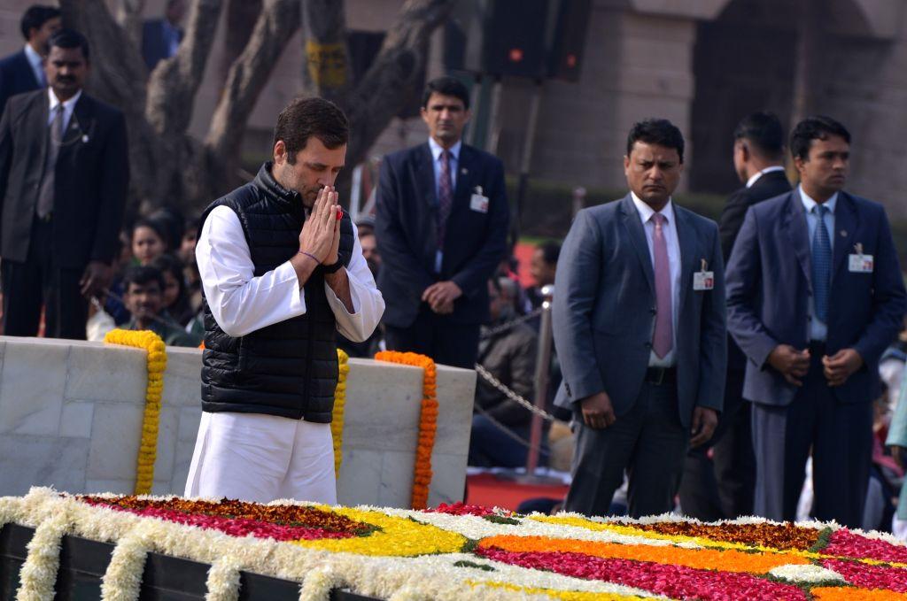 New Delhi: Congress president Rahul Gandhi pays tribute to Mahatma Gandhi on his death anniversary at Raj Ghat in New Delhi on Jan. 30, 2019. (Photo: IANS) - Rahul Gandhi