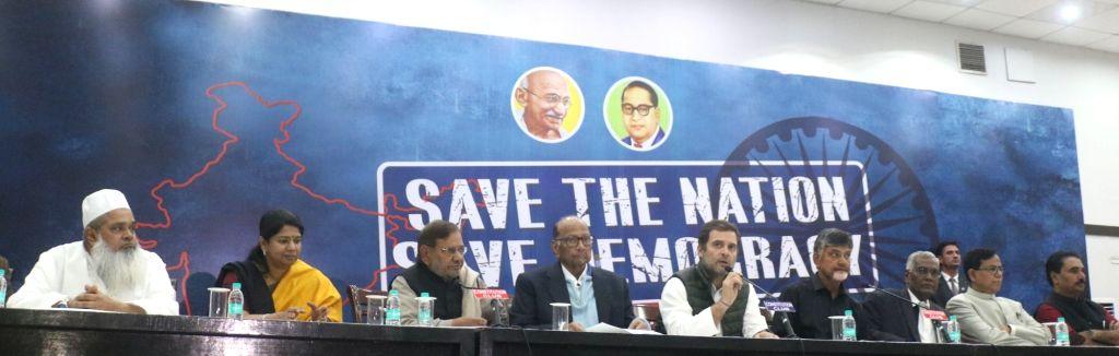 New Delhi: Congress President Rahul Gandhi with NCP chief Sharad Pawar, TDP chief Chandrababu Naidu, Loktantrik Janata Dal leader Sharad Yadav, DMK leader Kanimozhi, All India United Democratic Front (AIUDF) chief Maulana Badruddin Ajmal and CPI lead - Rahul Gandhi, Chandrababu Naidu and Sharad Yadav