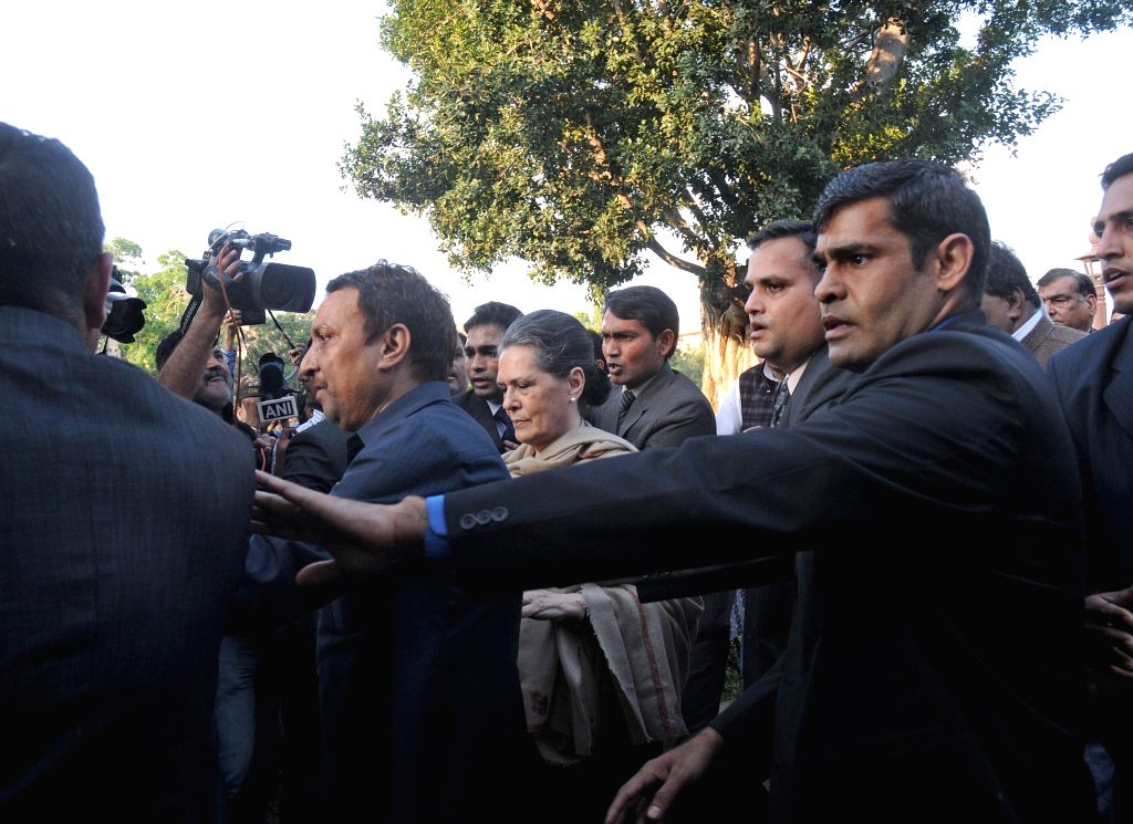 Congress president Sonia Gandhi leads a march of leaders and MPs of 10 political parties from the Parliament House to the Rashtrapati Bhawan to protest against the controversial land ... - Sonia Gandhi
