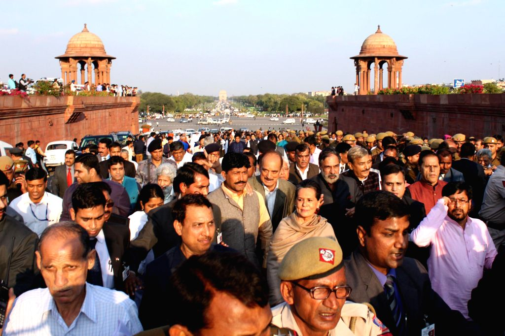 Congress president Sonia Gandhi leads a march of leaders and MPs of 10 political parties from the Parliament House to the Rashtrapati Bhawan to protest against the controversial land ... - Sonia Gandhi and Anand Sharma