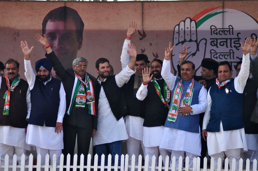Congress vice presdient Rahul Gandhi with Arvinder Singh Lovely and other leaders during a rally for the upcoming Delhi Assembly Election at Jahangir Puri in New Delhi on Feb. 4, 2015. - Arvinder Singh Lovely