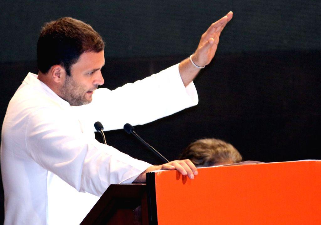 :New Delhi: Congress Vice President Rahul Gandhi addresses during a programme organised to celebrate the birth annivrsary of Pt. Jawaharlal Nehru at Nehru Bhawan in New Delhi on Nov. 7, 2015. ... - Rahul Gandhi and P. Joshi