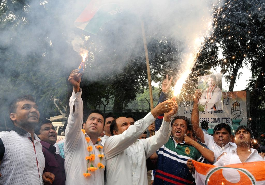 : New Delhi: Congress workers celebrate party's performance in the recently concluded Bihar assembly polls in New Delhi on Nov 8, 2015. (Photo: IANS).