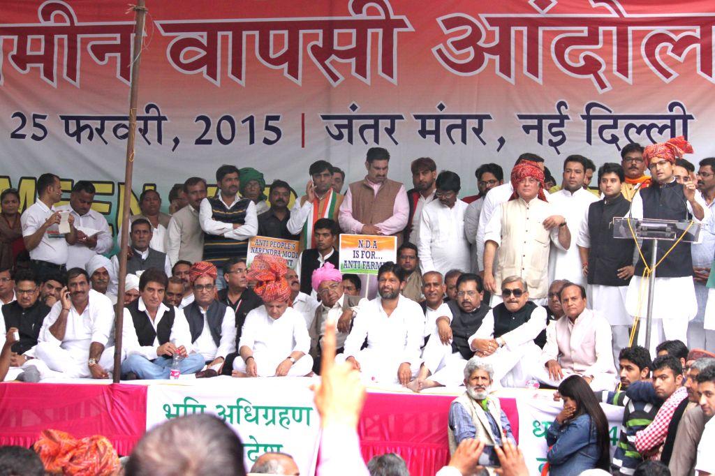 Congress workers participate in Zameen Vapasi Andolan at Jantar Mantar in New Delhi, on Feb 25, 2015.
