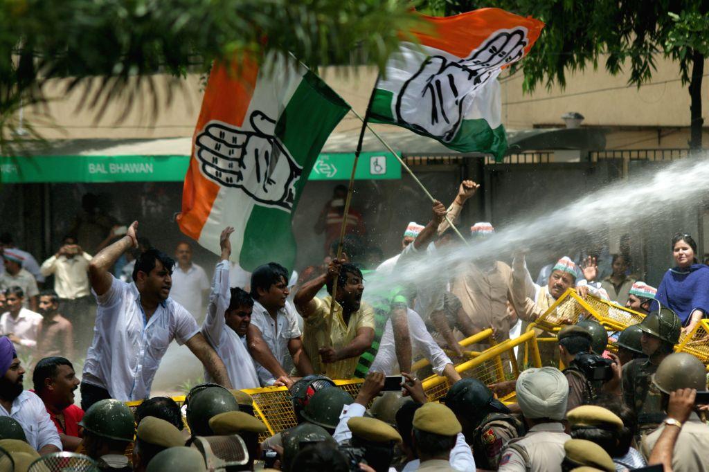 Congress workers protest against Delhi government demanding resignation of Delhi Law Minister Jitender Singh Tomar in New Delhi on April 30, 2015. - Jitender Singh Tomar