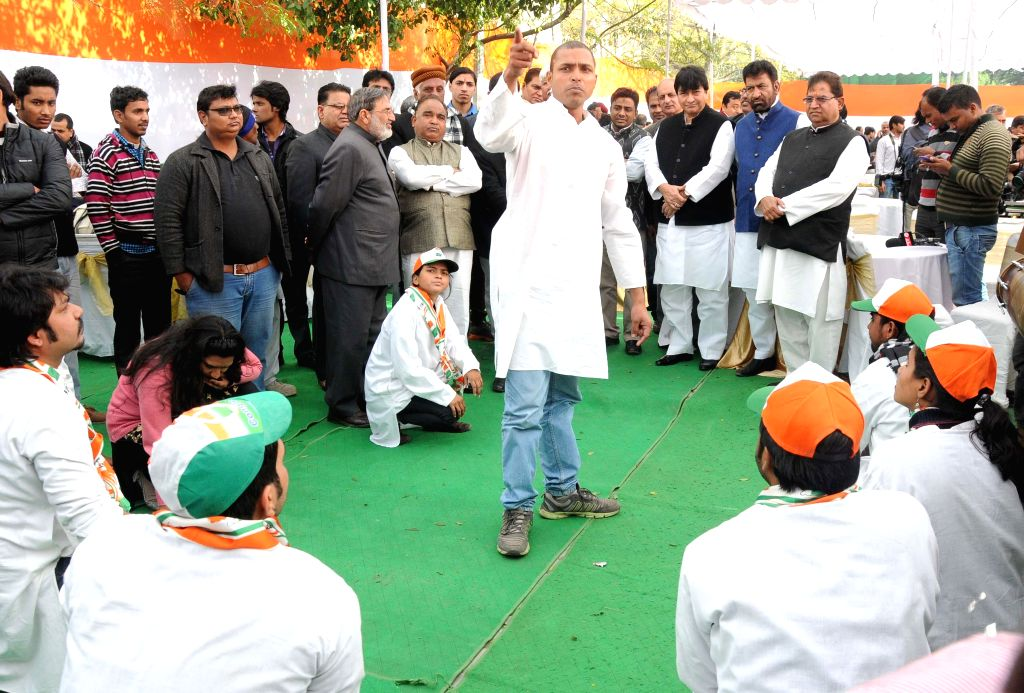 Congressmen stage a street play during a party programme in New Delhi, on Jan 5, 2015.