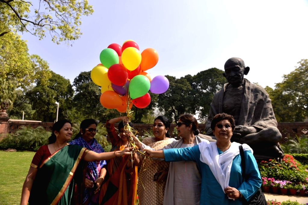 New Delhi: Conress women MPs release balloons to celebrate International Women's Day outside Parliament on March 8, 2018. (Photo: IANS)