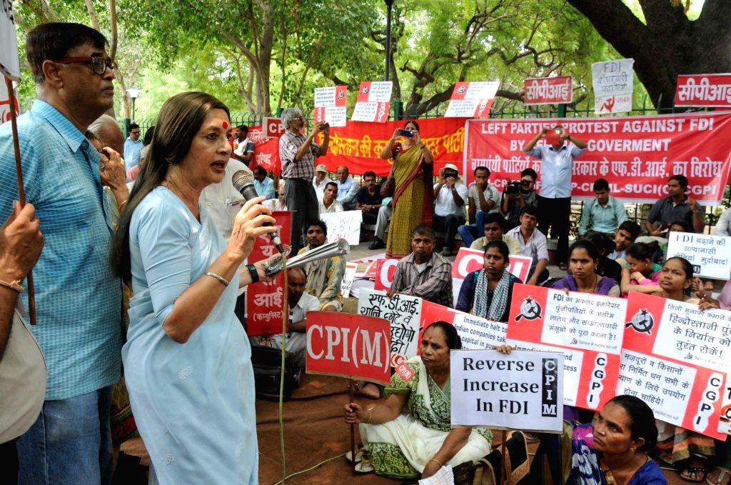 New Delhi: CPI (M) leader Brinda Karat addresses during a demonstration against FDI at Jantar Mantar in New Delhi on June 26, 2016. Seven left parties including CPI, CPI-M , Forward BlocK, ...