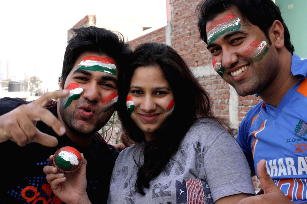 Cricket fans celebrate India's victory over Pakistan in an ICC World Cup 2015 match, in New Delhi, on Feb 15, 2015.