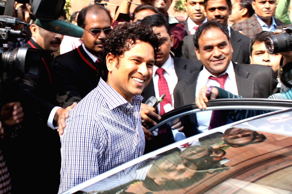 Cricket legend and Rajya Sabha member Sachin Tendulkar leaves the parliament premises after attending the first day of Parliament's winter session , in New Delhi, on Nov 24, 2014.