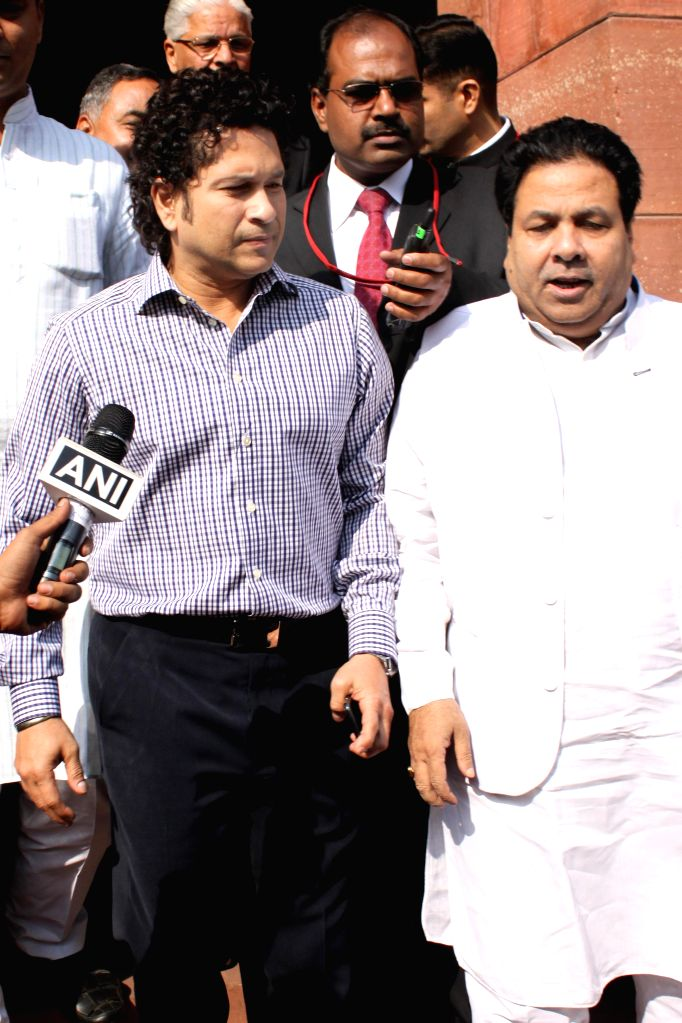 Cricket legend and Rajya Sabha member Sachin Tendulkar comes out after attending the first day of Parliament's winter session , in New Delhi, on Nov 24, 2014. Also seen Congress leader and