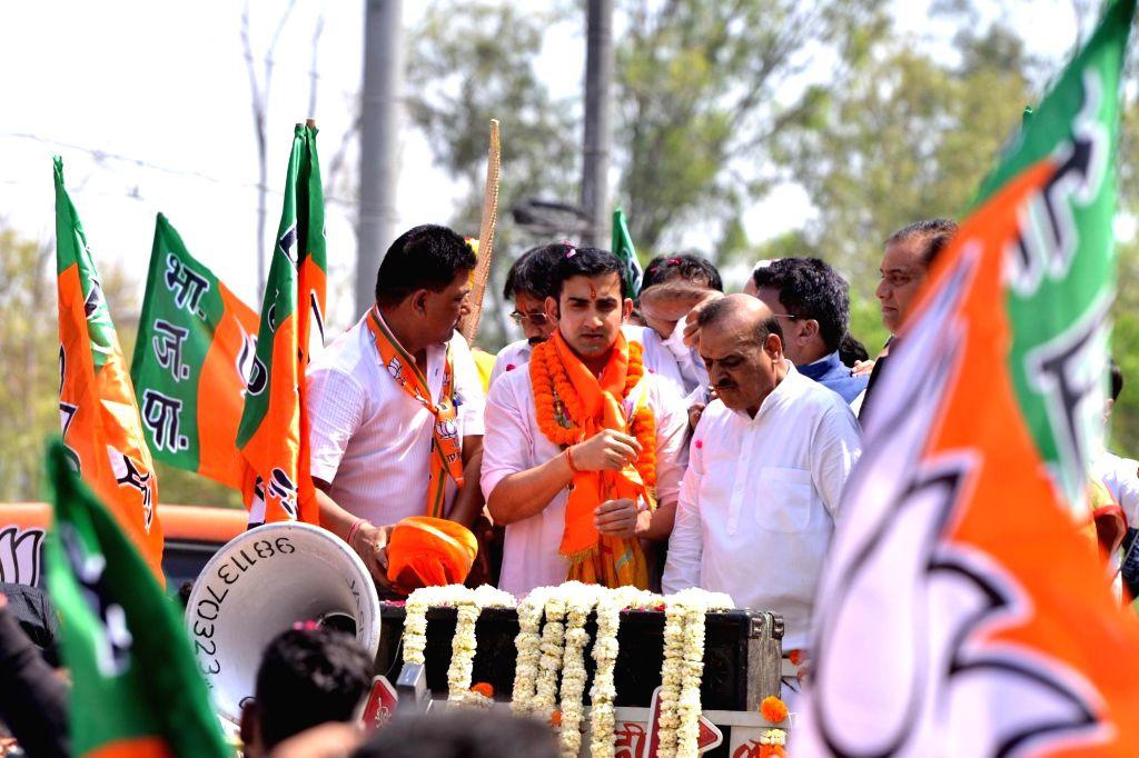 New Delhi: Cricketer-turned-politician, BJP Lok Sabha candidate from East Delhi, Gautam Gambhir during a roadshow before filing his nomination for the forthcoming Lok Sabha polls, in New Delhi, on April 23, 2019. (Photo: IANS)
