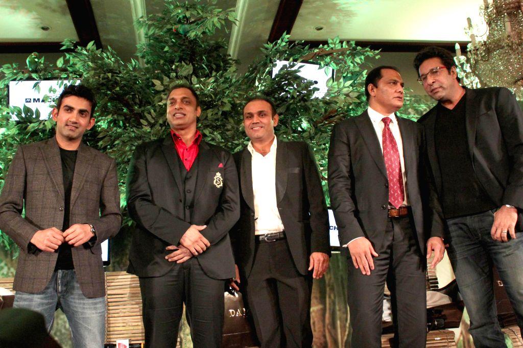 Cricketers Gautam Gambhir, Shoaib Akhtar, Virendra Sehwag, Mohammad Azharuddin and Wasim Akram during a programme organised by Aaj Tak news channel in New Delhi, on Dec 13, 2014. - Azharuddin