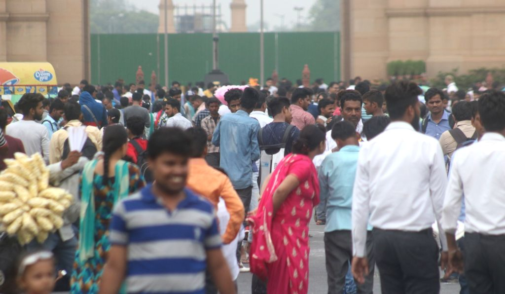 New Delhi: Crowd of visitors at the India Gate in New Delhi on July 11, 2018. World Population day which seeks to raise awareness about issues related to population, is globally observed on July 11 every year. (Photo: Bidesh Manna/IANS)