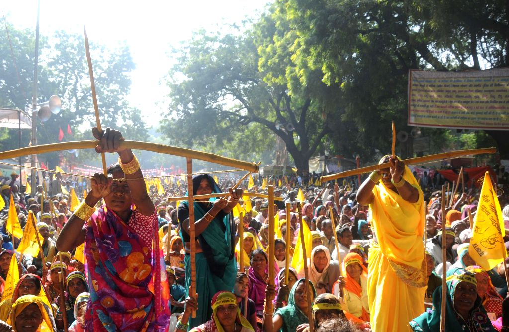 Dalit women participate in a rally organised under the banner of Rashtriya Dalit Assembly with their bows and arrows to press for their rights at Jantar Mantar in New Delhi, on Dec 5, ...