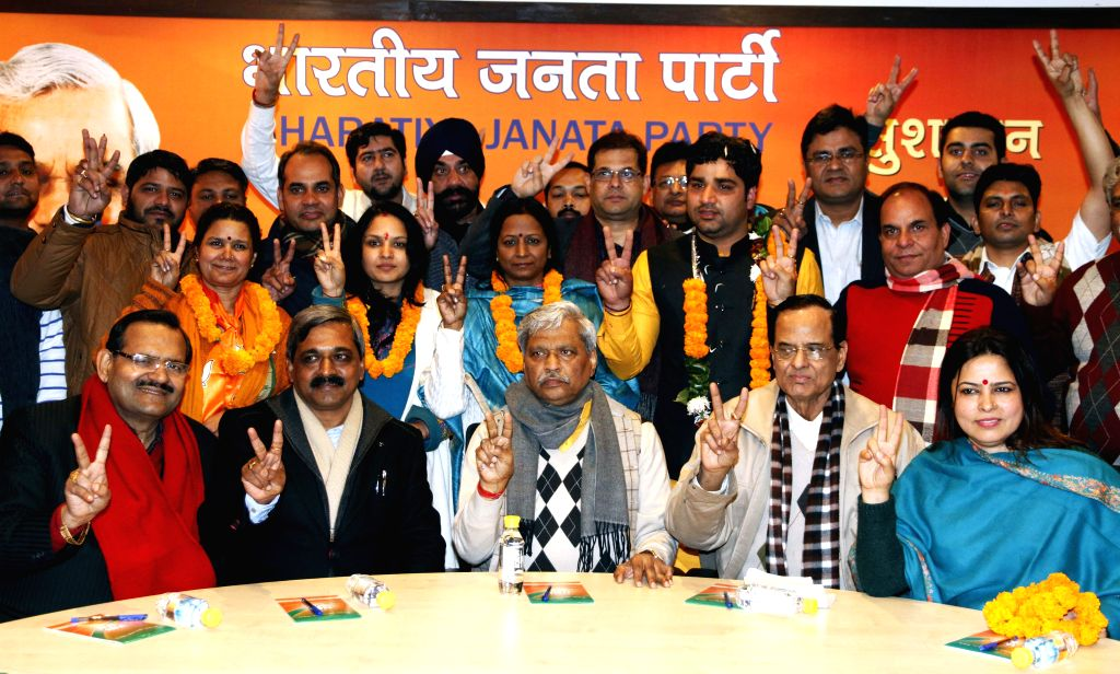 Delhi BJP chief Satish Upadhyay with the BJP candidates who were declared victorious in the recent elections to the eight member Delhi Cantonment Board at BJP office in in New Delhi, on ...