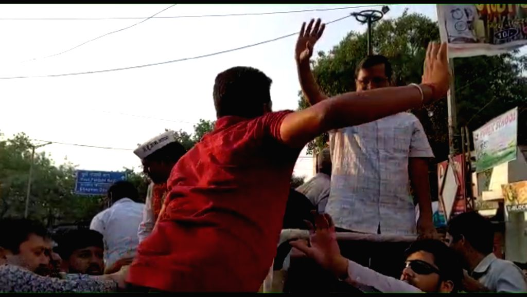 New Delhi: Delhi Chief Minister and Aam Aadmi Party (AAP) convenor Arvind Kejriwal was slapped during a road show in west Delhi's Moti Nagar area on May 4, 2019. (Photo: Video Grab/IANS) - Arvind Kejriwal