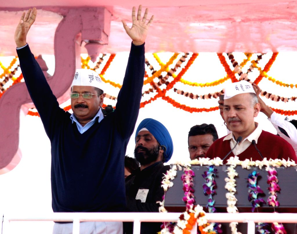 Delhi Chief Minister Arvind Kejriwal and Aam Aadmi Party (AAP) leader Manish Sisodia during oath taking ceremony of Kejriwal at Ramlila Maidan in New Delhi, on Feb 14, 2015. - Arvind Kejriwal