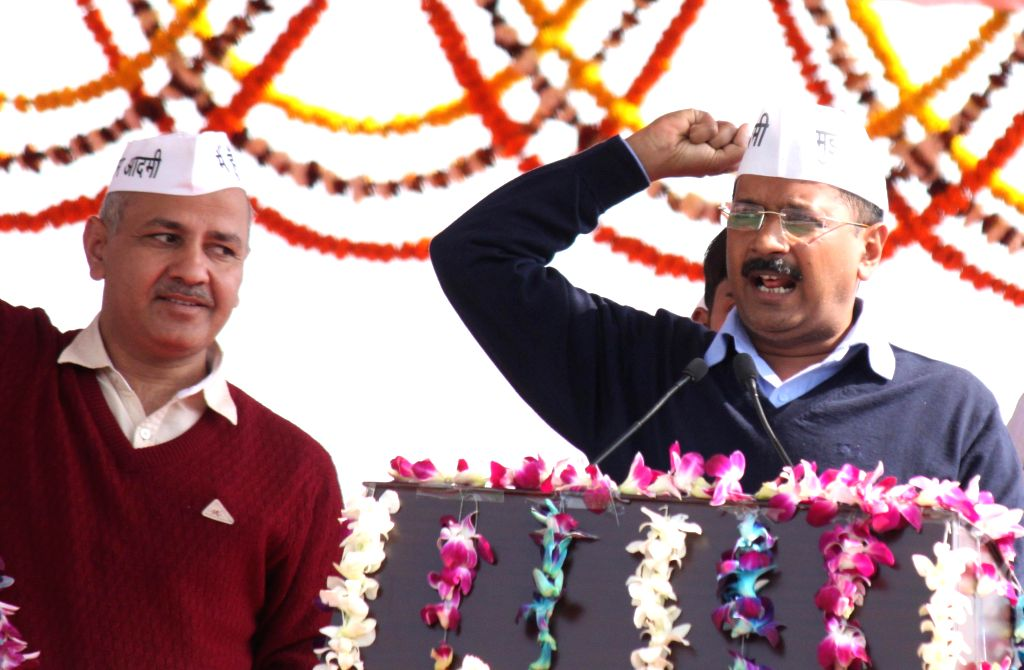 Delhi Chief Minister Arvind Kejriwal addresses public after taking oath at Ramlila Maidan in New Delhi, on Feb 14, 2015. Also seen Aam Aadmi Party (AAP) leader Manish Sisodia. - Arvind Kejriwal