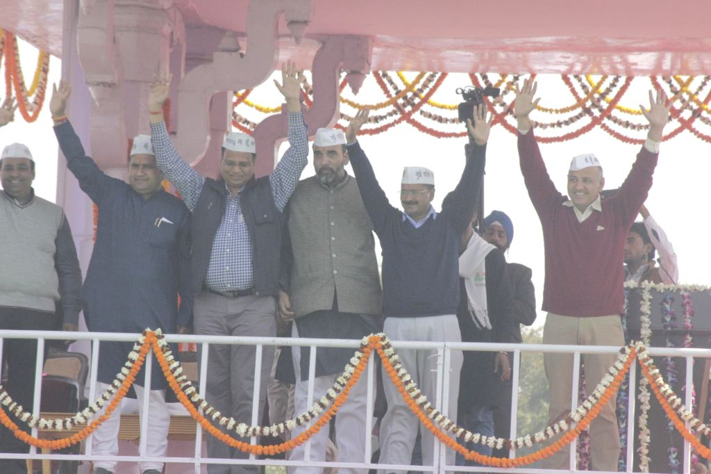 Delhi Chief Minister Arvind Kejriwal and Aam Aadmi Party (AAP) leaders Manish Sisodia, Gopal Rai, Satyendra Jain and others during the oath taking ceremony of Kejriwal at ... - Arvind Kejriwal, Gopal Rai and Satyendra Jain
