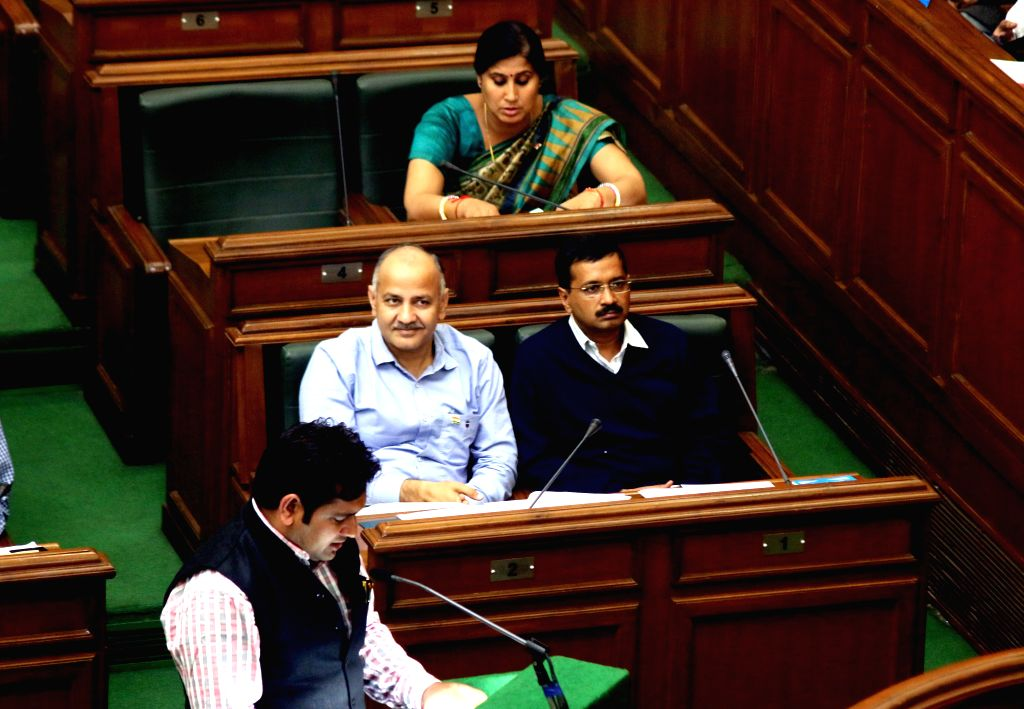 Delhi Chief Minister Arvind Kejriwal and Deputy Chief Minister Manish Sisodia during a Delhi Legislative Assembly session in New Delhi, on Feb 23, 2015. - Arvind Kejriwal