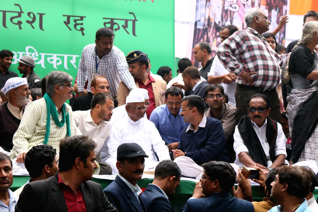 Delhi Chief Minister Arvind Kejriwal with social activist Anna Hazare during a demonstration against the land ordinance passed by the NDA government at Jantar Mantar in New Delhi, on Feb ...